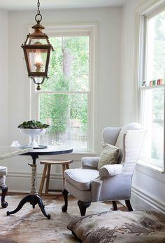 Inside Beautiful Botherum   Garden and Gun Wingback chair, dog beg