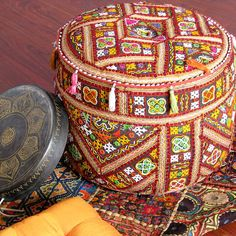 Indian patchwork pouf  (note to self-this came from a beautiful wall)