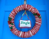 Items similar to white yarn wrapped holiday wreath with red felt flowers and pearl berries on Etsy, a global handmade and vintage marketplace.