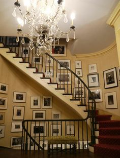 awesome stairs and picture arrangement around them !