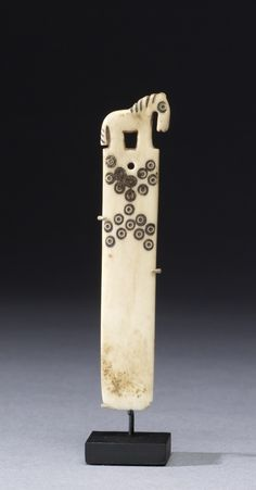 Peruvian weaving tool depicting a horse, bone, ca. AD 200 - 1520 (?)