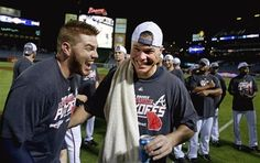 Atlanta Braves Chipper Jones celebrates with teammate Freddie Freeman after beating the Miami Marlins 4-3