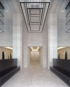 Entrance hall of one of the office blocks of the Upper Eastside Berlin project by GMP Architekten. Beautiful classical hall with clever use of mirrors to optically enlarge the space.