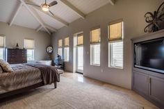 A master bedroom fit for a king (or queen) with a lux soaking tub in the corner that will have you feeling like you're at your own personal spa!