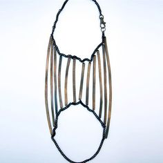 Shoulder Shadow Necklace now featured on Fab. made from bike inner tubes