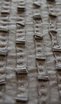 running stitch to attach raw bias strip, with intermittent gathered patches. try it in linen or silk - or try a batik strip over a solid ground!