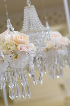 """Hmmm... could probably suspend petite floral/crystal """"centerpieces"""" like this from the beams in our ballroom.  Use fishing twine so it floats.  Would work well with family-style food service, so there's plenty of room for platters on the table below."""