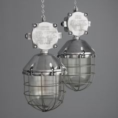 A pair of salvaged industrial Polish factory lights from Skinflint Design
