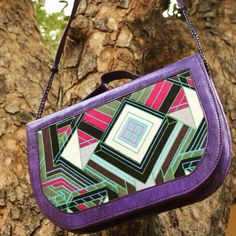 Hand dyed purple leather bag that can be worn as a #clutch or #crossbody featuring the same fabric as @globe_traveller's own #Teespoon #Weekender.