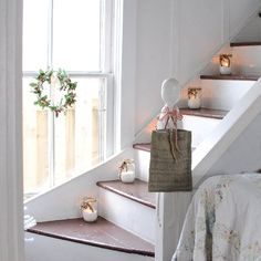 Infusing farmhouse style during the holidays or any other time is easy with simple items like mason jar votives and fuss-free wreaths.