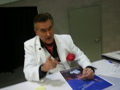 Bruce Campbell signing my daughters evil dead poster at comikaze 2013