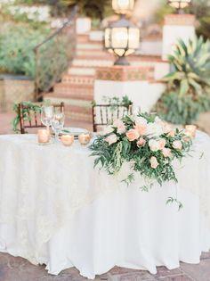 Peach and blush floral covered wedding table: http://www.stylemepretty.com/little-black-book-blog/2015/12/08/peach-blush-hummingbird-nest-ranch-wedding/   Photography: Honey Honey - http://hoooney.com/