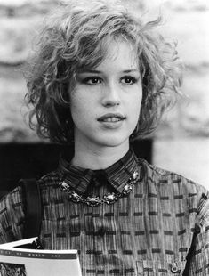 Even in a simple outfit Molly Ringwald's confidence makes her look fantastic and stylish.  #styleicon #modcloth