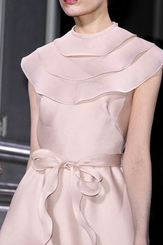 A delicate cocktail or black tie dress.  I am still trying to find out who the designer is.  The bow is simply the subtle WOW factor.