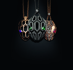 A trio of Bulgari Serpenti Seduttori pendant necklaces in rose and white gold with emerald, ruby or amethyst eyes and different diamond setting options.