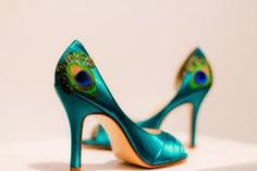 Looks easy enough to recreate with a Maybe do this to my teal heels? little glue and a feather...  Teal Satin Pleated Peep Toe Peacock Pumps  ANY by LaPlumeEthere
