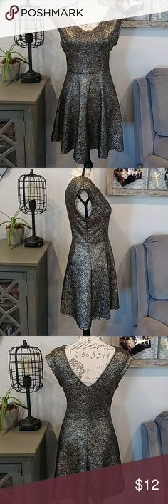 Stretchy sparkly party dress Super stretchy glittery party dress withlow cut back. V neck, sleeveless and skate skirt. Very comfortable for a dressy dress ❤ one clothing Dresses