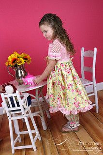 Soft as rose petals at dawn, this bolero is sure to win any little girl's heart! The cropped bolero features dainty tiered sleeves, overlapping fronts tied with ribbon, and stylish flower accents at the neckline and on the back panel. Better yet, place the accents anywhere you please and make it truly one-of-a-kind! Worked in sport weight yarn, this irresistible piece will be the perfect addition to your little girl's spring and summer wardrobe.