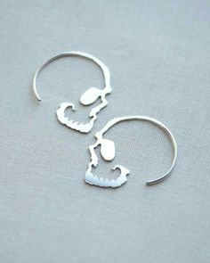 Silver Skull Hoop Earrings by Olive Yew. Unique and edgy, our simple skull hoop earrings are the perfect accessory. These are cut and handmade with love from sterling silver and measure 1 inch by 1 inch. Skull Earrings, Skull Jewelry, Body Jewelry, Jewelry Box, Jewelry Accessories, Jewelry Design, Hoop Earrings, Silver Earrings, Jewelry Storage