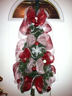 "My Christmas tree door wreath that I made for a teacher at my son's school. Red & white window pane deco mesh & solid red mesh with ornaments used on a teardrop wreath form. ""MY WREATH CREATIONS"" by Sherry Ballew. Deco Mesh Wreaths, Door Wreaths, Ornament Wreath, Ornaments, Christmas Swags, Wreath Forms, How To Make Wreaths, Garland, Red And White"