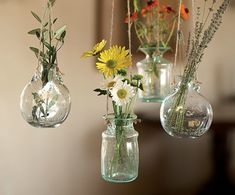 little hanging jars with tiny flowers!  There is nothing that is not cute about this.