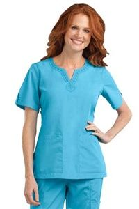 Peaches Uniforms Vicky Top 4290 • Embroidered neckline  • Side slits on sleeves and hem  • Roomy patch pockets $20.70 #scrubs #scrubcouture #nurses