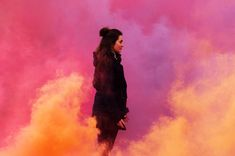 Photo highlights of the day: London smoke bombs and a Spanish tenor