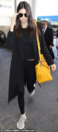 Kendall Jenner in Adidas x Kanye West shoes, Louis Vuitton bag - In Los Angeles.  (25 June 2015)
