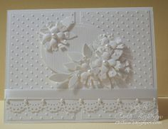 Another beautiful all-white card with layers, texture, pearls, flowers...
