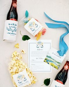 """Brittany and Alex welcomed their friends and families with a bag of goodies, including """"something sweet"""" (sour gummy fish, the bride's favorite), """"something salty"""" (popcorn), and locally-made Cheerwine soda. The edible treats had custom labels printed with the couple's crest and artwork from the invitations. #weddingwelcomebags #welcomebags #weddingdetails #weddingideas 