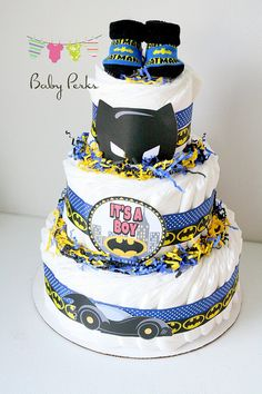 PLEASE READ SHOP ANNOUNCEMENT FOR CURRENT TURNAROUND TIME BEFORE PLACING YOUR ORDER Diaper cake Royal Blue/ Black /Yellow 1 pair Booties { may vary in