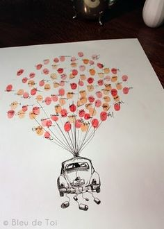 """What an awesome guest book idea! I would love to do this for a baby shower and then hang it in the baby's room.  It could even be balloons tied to a """"bundle of joy""""!!"""