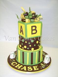For jamaican theme, use black, yellow and green and put baby's last name! And then cupcakes around it!! :)