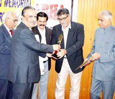 Advisor to Chief Minister Prof Amitabh Mattoo presenting award to journalist Ramesh Kumar Mattoo at Jammu.