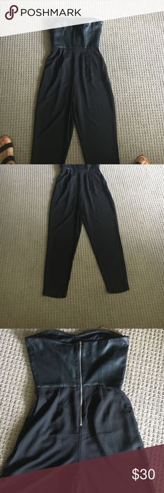 Leather strapless jumpsuit crepe tapered pant leg Size small by One Clothing purchased at Nordstrom and never worn just hanging in my closet. Exposed zipper on the back. Pleats in the front and tapered leg. Adorable on!!! Not age appropriate for me unfortunately no flaws like new and smoke free home. Top part is sweetheart style and is faux leather one clothing Pants Jumpsuits & Rompers