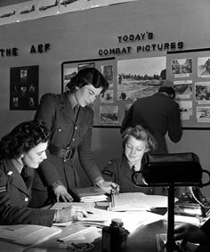 World War II, 15th June 1944, England, Press Information during the D-Day Invasion of France, The list of accredited correspondents are checked by Junior Commander JH Begg (standing) and two WAAF and CWAC Information Room assistants (Photo by Popperfoto/Getty Images)