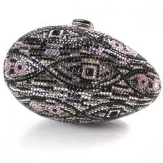 This is an authentic JUDITH LEIBER Swarovski Crystal Egg Minaudiere Clutch.   This is a stunning hard evening clutch that is entirely encrusted with multicolor Swarovski crystals in a graphic patttern in the form of an magnificent egg.