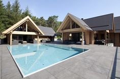 Natural wood and stone combined in an elegant way. A Honka log home in the Netherlands.