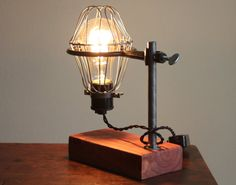 Industrial desk lamp with 40W vintage-style Edison bulb. Made from a vintage Bunsen ring, steel bulb cage and salvaged cedar