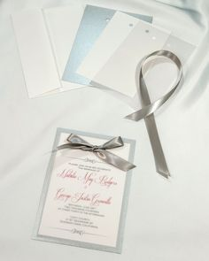 Deep Silver Layered Invitations simple yet elegant. Each kit comes with a backer card, invitation card, vellum, ribbon and envelope. Easy to print, beautiful to send. Only $22.95 for twenty invitations. https://www.weddingbellinvitations.com/categories/2-single-card-kits/products/90-deep-silver-layered-invitations #wedding invitations