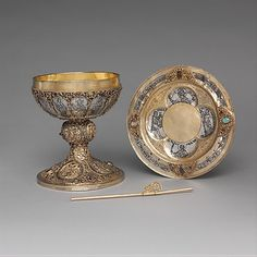 Chalice, ca. 1230–50. German. The Metropolitan Museum of Art, New York. The Cloisters Collection, 1947 (47.101.26) | This ensemble contains  all the elements needed for the celebration of the Mass: the paten for the bread, the chalice to hold the wine, and a straw to sip it. #Cloisters
