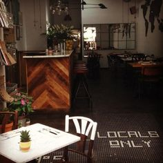 Locals Only IBIZA Reclaimed Chevron Wood Bar, Penny Tile on the Floor Entrance, Dipped Wood Chair, Planters, Marble Table. Tile Floor Diy, Marble Floor, Chair Planter, American Flag Wood, Penny Tile, Reclaimed Barn Wood, Marble Pattern, Porch Signs, Wood Bars