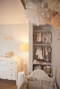 Peach and grey nursery. Cute wardrobe too!
