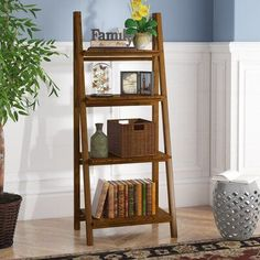 Andover Mills™ Bring a personal touch to any space in your home with this versatile ladder bookcase, perfect for showing off framed family photos, potted plants, or a few of your favorite novels. Made from solid wood, it strikes a tall and narrow silhouette measuring 60'' H x 24'' W x 16'' D overall to make the most of your square footage. A neutral wood grain finish gives it the versatility to blend with your existing arrangement, while the slatted design #LaminateFlooringPrices Ladder Bookshelf, Wood Ladder, Cube Bookcase, Etagere Bookcase, Bookcases, Leaning Bookshelf, Bookshelf Ideas, Bookshelf Design, Laminate Flooring Prices