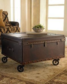 trunk coffee table. Love the idea to put wheels on it!