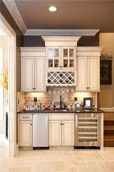 Wet bar: wine fridge and ice machine a must for entertaining! COFFEE BAR AND DRINK STATION: