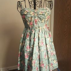 Mint floral dress Brand: forever 21, Color: mint with pink, yellow, and white floral accent, Size: Small,  Condition: New, never worn but no tags Forever 21 Dresses