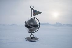"Detail of the time capsule photographed at the North Pole. A ""flag for the future"" is attached to the glass and titanium time capsule containing 2.7 million names of supporters who wish to protect the Arctic. A Greenpeace team will lower the capsule and a 'flag for the future' to the seabed beneath the North Pole 