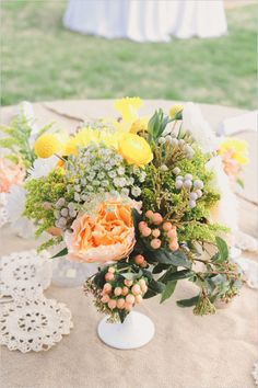yellow and peach floral centerpiece