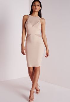 Work a standout silhouette this season in this nude midi dress. With fierce mesh insert under and v neck crepe number to the top this cut out beaut is a must have to get those killer curves. Team with strappy nude heels and oversized clutch...